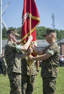 U.S. Marine Corps Lt. Col. Robert E. Cato II, outgoing commanding officer for Security Battalion (SECBN) presents the organizational colors to Lt. Col. Mark T. Schnakenberg, incoming commanding officer, during a change of command ceremony held at Lejeune Field, Marine Corps Base Quantico, June 21, 2017. The ceremony was held to transition command from Cato to Shnakenberg. (U.S. Marine Corps photo by: Lance Cpl. Micha R. Pierce)