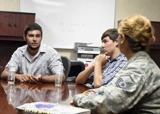Jeremiah Treadwell, left, and his brother Benjamin, middle, discuss their interest in joining the military with Master Sgt. Caroline Bunce, 628th Aerospace Medical Squadron dental hygienist, during a tour of the Deily Dental Clinic July 25. Jeremiah is a cancer survivor who met Bunce through her work with the Courageous Kidz program. Now in full remission, Jeremiah participates in various youth programs to prepare himself for a future of military service.