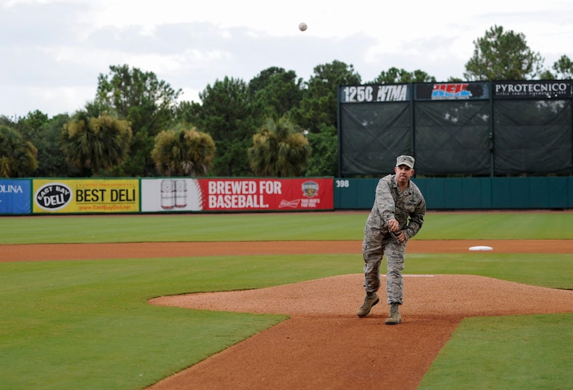 U.S. Air Force Col. Patrick Winstead, 437th Airlift Wing vice commander, throws a ceremonial first pitch during the Charleston RiverDogs Military Appreciation Night at Joseph P. Riley Jr. Park, Aug. 3, 2017.