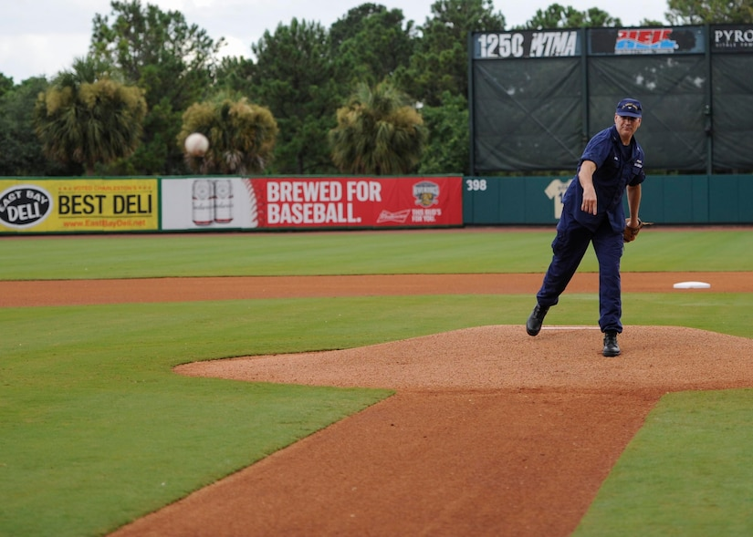 U.S. Coast Guard Capt. Gregory Stump, Coast Guard Sector Charleston commander, throws a ceremonial first pitch during the Charleston RiverDogs Military Appreciation Night at Joseph P. Riley Jr. Park, Aug. 3, 2017.