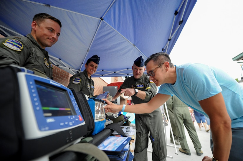 Robert Brittingham, U.S. Air Force veteran, left, learns about medical equipment from the 315th Aeromedical Evacuation Squadron during the Charleston RiverDogs Military Appreciation Night at Joseph P. Riley Jr. Park, Aug. 3, 2017.
