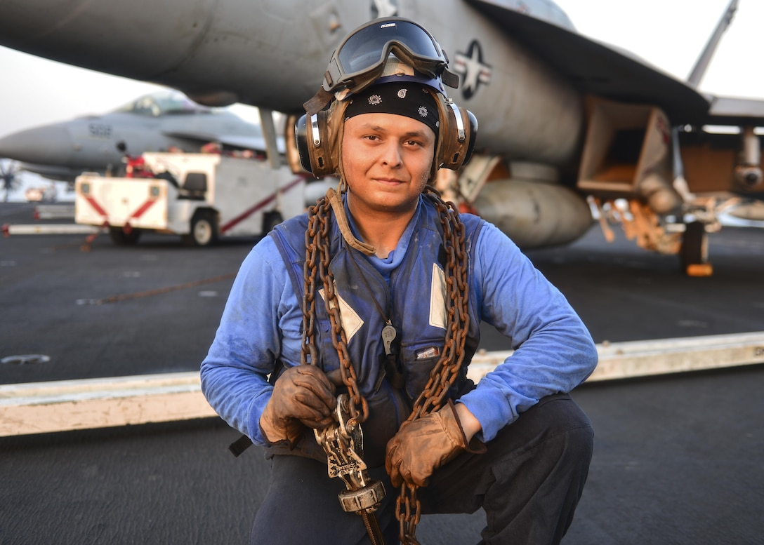 ARABIAN GULF (Aug 4, 2017) U.S. Navy Airman Michaell Lathrop, from Atlanta, poses for a photo aboard the aircraft carrier USS Nimitz (CVN 68), Aug. 4, 2017, in the Arabian Gulf. Nimitz is deployed in the U.S. 5th Fleet area of operations in support of Operation Inherent Resolve. While in this region, the ship and strike group are conducting maritime security operations to reassure allies and partners, preserve freedom of navigation, and maintain the free flow of commerce. (U.S. Navy photo by Mass Communication Specialist 3rd Class Ian Kinkead)