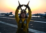 ARABIAN GULF (Aug 4, 2017) U.S. Navy Aviation Boatswain's Mate (Handling) 3rd Class Melanie Cluck, from Palm Springs, Calif., poses for a photo aboard the aircraft carrier USS Nimitz (CVN 68), Aug. 4, 2017, in the Arabian Gulf. Nimitz is deployed in the U.S. 5th Fleet area of operations in support of Operation Inherent Resolve. While in this region, the ship and strike group are conducting maritime security operations to reassure allies and partners, preserve freedom of navigation, and maintain the free flow of commerce. (U.S. Navy photo by Mass Communication Specialist 3rd Class Ian Kinkead)
