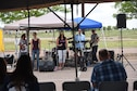 SCHRIEVER AIR FORCE BASE, Colo. -- A local cover band, MixTape, performs for 310th Space Wing members attending the wing's annual family picnic on Sunday, Aug. 6, 2017. A variety of games were provided for Airmen and their families after enjoying hamburgers and hotdogs fresh off the grill. (U.S. Air Force photo/Senior Airman Sam Salopek)