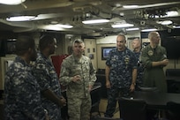 U.S. Navy Vice Adm. Charles Richard (center right), deputy commander of U.S. Strategic Command (USSTRATCOM), and U.S. Air Force Chief Master Sgt. Patrick McMahon (center left), USSTRATCOM senior enlisted leader, speak to sailors aboard USS Alaska (SSBN 732) during a visit to Naval Submarine Base Kings Bay, Ga., Aug. 3, 2017. While there, Richard and McMahon presented the 2016 Omaha Trophy, ballistic missile submarine category, to leaders and crew members of USS Alaska in recognition of their contributions to strategic deterrence. The Omaha Trophy, which dates back to the U.S. Air Force's Strategic Air Command, was originally created by the Strategic Command Consultation Committee in 1971. At the time, a single trophy was presented the organization's best wing. The tradition later evolved to five awards that recognize USSTRATCOM's premier intercontinental ballistic missile wing, ballistic missile submarine, strategic bomber wing, global operations (space/cyberspace) unit and strategic aircraft wing.