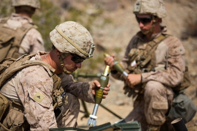 Marines from 1st Battalion, 1st Marine Regiment, prepare for a rapid fire on the enemy target during an individual training exercise at Range 410A aboard the Marine Corps Air Ground Combat Center, Twentynine Palms, Calif., July 25, 2017. 1/1 is based out of Marine Corps Base Camp Pendleton, Calif., and is serving as part of the GCE during ITX 5-17. (U.S. Marine Corps photo by Pfc. Margaret Gale)