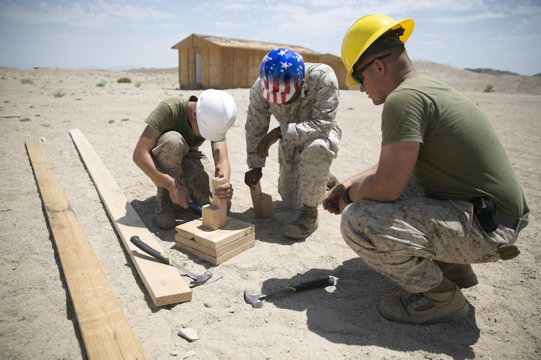 Marines with the engineer platoon for Marine Wing Support Squadron 272, construct a foundation for a Southwest Asia hut aboard the Combat Center during Integrated Training Exercise 5-17, July 29, 2017. MWSS-272 is supporting the Aviation Combat Element of the ITX. The ACE conducts offensive, defensive, and all other air operations to support the MAGTF mission . (U.S. Marine Corps photo by Cpl. Medina Ayala-Lo)