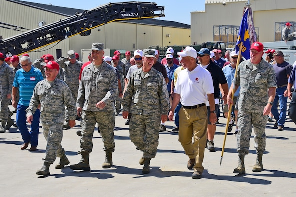 (Left to right) 219th RED HORSE Squadron Commander Col. Rusty Vaira walks with former 219th RHS commanders Col. Ryck Cayer, Col. Corey Halvorson and retired Col. Gary Shick. The officers participated in the 20th anniversary celebration recognizing the reactivation of the active duty United States Air Force 819th RED HORSE Squadron and the activation of the 219th RHS of the Montana Air National Guard in the Airfields Building at Malmstrom Air Force Base, Mont. July 20, 2017.
