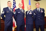 Master Sgt. Christopher, Master Sgt. Raymond, Tech Sgt. Courtney, and Staff Sgt. Matthew pose for a group photo after graduation from Remotely Piloted Aircraft Training at Joint Base San Antonio - Randolph.  Courtney is the first female enlisted pilot and Matthew was the distinguished honor graduate.  All four are part of the Air Force's Enlisted Pilot Initial Class initiative that merges officer and enlisted pilot candidates in one class for the duration of training.  Surnames were witheld and to comply with Air Force guidelines on the release of names for intelligence, surveillance, and reconnaissance personnel.  (Photo Illustration/Randy Martin)