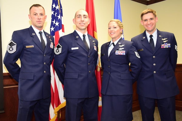 Master Sgt. Christopher, Master Sgt. Raymond, Tech Sgt. Courtney, and Staff Sgt. Matthew pose for a group photo after graduation from Remotely Piloted Aircraft Training at Joint Base San Antonio - Randolph.