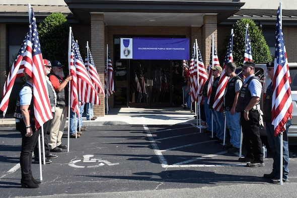 Volunteers present American flags at the entrance to the Goldsboro/Wayne Purple Heart Foundation Purple Heart banquet, Aug. 4, 2017, in Goldsboro, North Carolina. The banquet honored Purple Heart recipients, Gold Star families and post-military deceased veteran's families. (U.S. Air Force photo by Airman 1st Class Victoria Boyton)