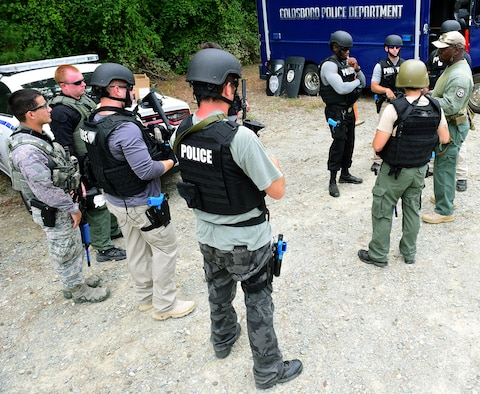 A.A. Boone, founder and president of Specialized Realistic Training Inc. (right), instructs students on the basic SWAT course before entering the shoot-house, Aug. 3, 2017, at Seymour Johnson Air Force Base, North Carolina. While most of the students are from the Goldsboro Police Department and Wayne Community College, two Airmen from the 4th Security Forces Squadron were invited to participate in the training. (U.S. Air Force photo by Airman 1st Class Kenneth Boyton)
