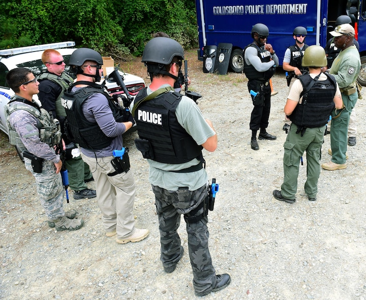 A.A. Boone, founder and president of Specialized Realistic Training Inc. (right), instructs students on the basic SWAT course before entering the shoot-house, Aug. 3, 2017, at Seymour Johnson Air Force Base, North Carolina.