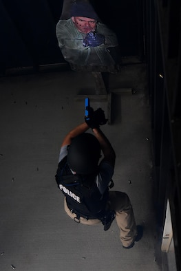 A Goldsboro Police Officer fires Simunition rounds at a hostile target during a basic SWAT course at the shoot-house on Seymour Johnson Air Force Base, North Carolina, Aug. 3, 2017. The training instills students with the mindset to survive and to trust their team members. (U.S. Air Force photo by Airman 1st Class Kenneth Boyton)