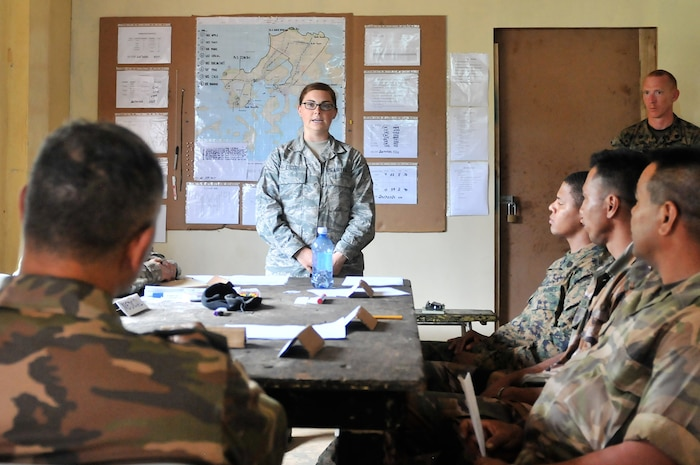 Staff Sgt. Makaila Erdody, a cardio pulmonary respiratory therapist with the Nevada Air Guard's 152nd Medical Group, briefs the Tongan Army command staff team on the status of injured service members during Exercise Tafakula on the island of Vava'u, Tonga, on July 26,  2017.