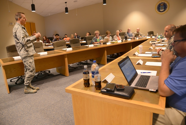 Col. Mark Mocio, chief of the Legacy Tanker Division C/KC-135, speaks to attendees at the division's recent annual System Supportability Review event at the General Hill Conference Center.