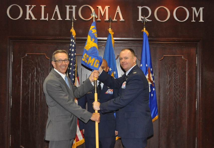 Col. Robert A. Kielty received the guidon from 448th Supply Chain Management Wing director Frank Washburn, as he assumed command of the 848th Supply Chain Management Group.
