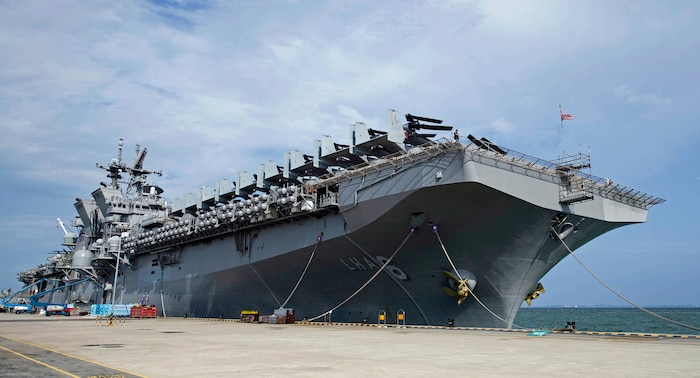 The amphibious assault ship USS America (LHA 6) sits along the pier at Changi Naval Base after arriving for a scheduled port visit, Aug. 6, 2017. America is in Singapore to enhance U.S. and Singapore relations and experience the culture of the country. America is currently embarked on its maiden deployment and is part of the America ARG comprised of more than 1,800 Sailors and 2,600 Marines assigned to the amphibious dock landing ship USS Pearl Harbor (LSD 52), the amphibious transport dock ship USS San Diego (LPD 22) and America.