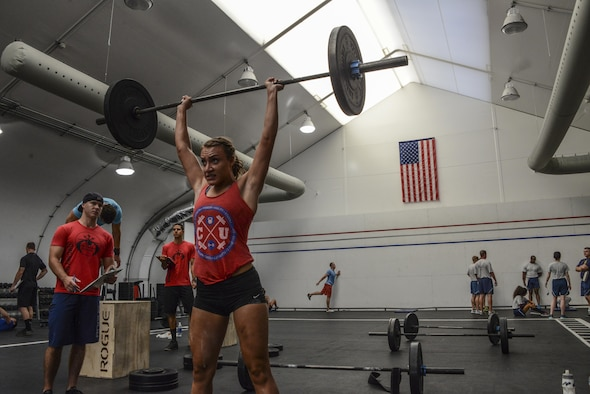 Haleigh Wheat, 31 heroes competition participant, performs a barbell thruster during the 31 heroes competition held at Luke Air Force Base, Ariz., August 4, 2017. Service members from each branch were present during the competition which was open to anyone who wanted to participate. (U.S. Air Force photo/Airman 1st Class Caleb Worpel)