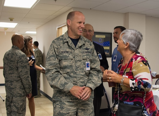 Brigadier General Evan Dertien, 96th Test Wing commander, speaks with Cecilia Jones, Walton County District 2 commissioner at the Walton County Chamber of Commerce First Friday Breakfast, Aug. 4, at Eglin Air Force Base, Fla. The 20th Space Control Squadron hosted the chamber's monthly breakfast to combine networking and provide insight into space operations with a presentation and a tour of the facility. (U.S. Air Force photo/Kristin Stewart)