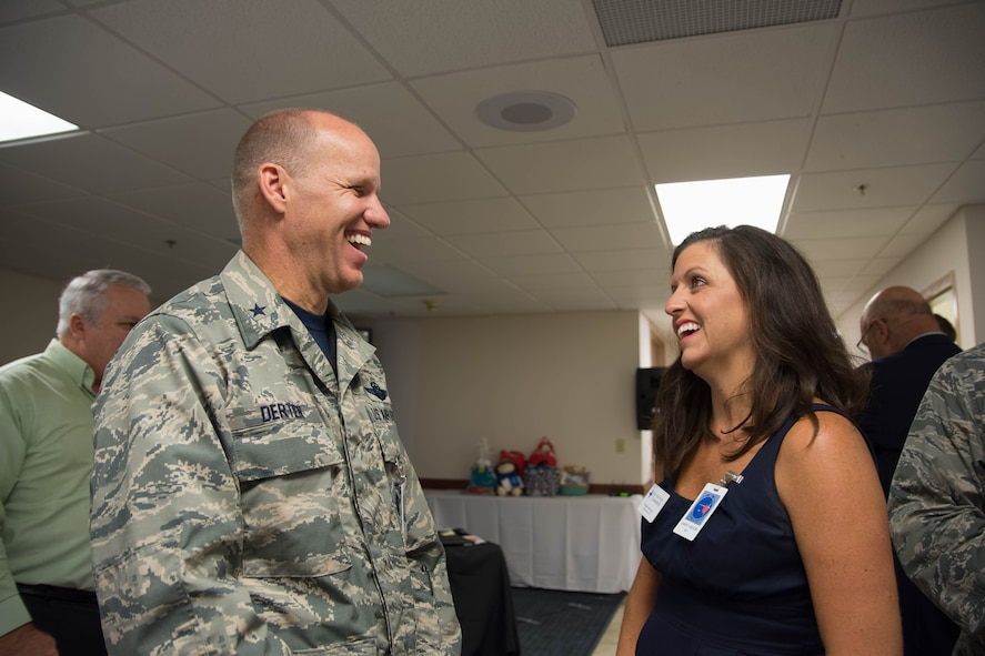 Brigadier General Evan Dertien, 96th Test Wing commander, greets Megan Harrison, Walton County Chamber of Commerce president at the Walton County Chamber of Commerce First Friday Breakfast, Aug. 4, at Eglin Air Force Base, Fla. The 20th Space Control Squadron hosted the chamber's monthly breakfast to combine networking and provide insight into space operations with a presentation and a tour of the facility. (U.S. Air Force photo/Kristin Stewart)