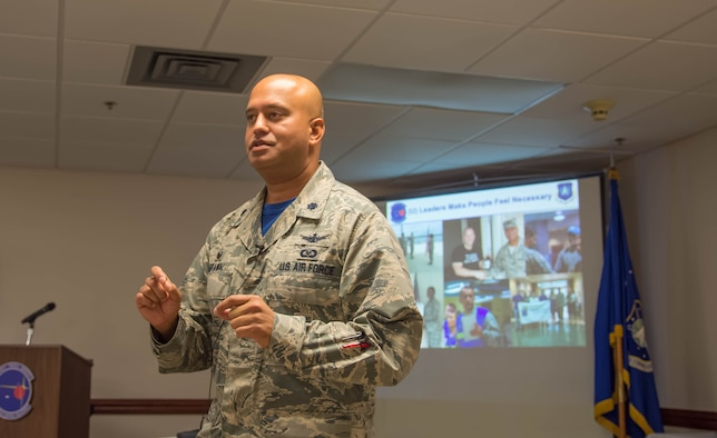 Lieutenant Colonel Raj Agrawal, 20th Space Control Squadron commander and guest speaker, briefs leadership principles and the 20th SPCS mission at the Walton County Chamber of Commerce First Friday Breakfast, Aug. 4, at Eglin Air Force Base, Fla. The 20th Space Control Squadron hosted the chamber's monthly breakfast to combine networking and provide insight into space operations with a presentation and a tour of the facility. (U.S. Air Force photo/Kristin Stewart)