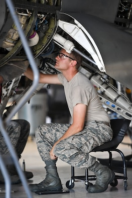 Staff Sgt. Colby Cole, a crew chief assigned to the 419th Maintenance Squadron, disconnects F-16 Fighting Falcon aircraft hydraulic lines during phase maintenance at Hill Air Force Base, July 26. The jet pictured is the last Hill AFB F-16 to go through phase at the base. The 388th and 419th Fighter Wings are transitioning to the F-35A Lightning II. (Paul Holcomb/U.S. Air Force)