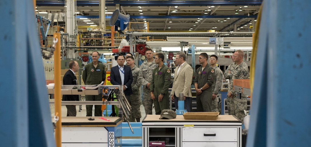 Defense contractors give a tour to airmen from the 366th Fighter Wing of Mountain Home Air Force Base, Idaho, during their visit to the factory Aug. 3, 2017, in St. Louis, Mo. Gunfighters toured the F-15E Strike Eagle production line and the weapons factory during their visit. (U.S. Air Force photo by Senior Airman Jeremy L. Mosier)