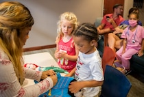 The 96th Medical Group's pediatric clinic hosted 127 children during their first Teddy Bear Clinic to educate them about hospital procedures and to demonstrate what they may expect if they need to see a doctor.