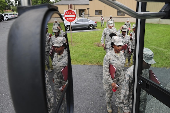 Members of the 413th Aeromedical Staging Squadron board a bus Aug. 4, 2017, at Robins Air Force Base, Ga. The Airmen later flew to Dobbins Air Reserve Base, Ga., where they trained on their ability to medically and administratively prepare patients for flight in a deployed environment. (U.S. Air Force photo by Jamal D. Sutter)