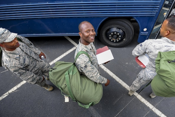 Senior Airman Bright Gyebi, 413th Aeromedical Staging Squadron health services specialist, shares a smile with the camera as he boards a bus Aug. 4 during Exercise Avian 2017 at Dobbins Air Reserve Base, Ga. Nearly 50 of the squadron's Airmen traveled to Dobbins to take part in the three-day exercise to train on staging and holding patients in preparation for flight. (U.S. Air Force photo by Jamal D. Sutter)