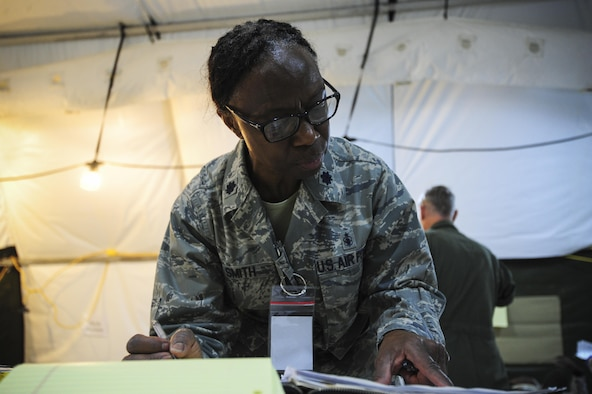 Lt. Col. Mable Smith, 413th Aeromedical Staging Squadron chief of nursing service, reviews information Aug. 5 during Exercise Avian 2017 at Dobbins Air Reserve Base, Ga. During the exercise, Smith served as the officer in charge of the mission. In that role, Smith was responsible for all issues or concerns regarding the team's operations. (U.S. Air Force photo by Jamal D. Sutter)