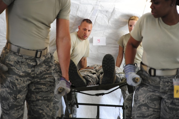 Members of the 413th Aeromedical Staging Squadron prepare to transport a patient Aug. 5 during Exercise Avian 2017 at Dobbins Air Reserve Base, Ga. Exercise Avian is designed to train 413th ASTS Airmen on their ability to medically and administratively prepare patients for flight in a deployed environment. (U.S. Air Force photo by Jamal D. Sutter)