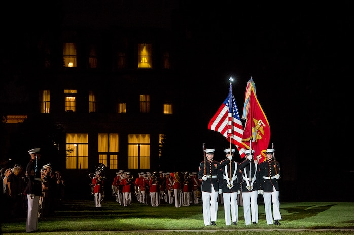 The U.S. Marine Corps Color Guard marches across the parade deck during the Staff Noncommissioned Officer Evening Parade at Marine Barracks Washington D.C., Aug. 4, 2017. The guest of honor for the parade was retired Marine Corps Col. Archie Simpson, Guadalcanal veteran, and the hosting official was Lt. Gen. James B. Laster, director, Marine Corps Staff. (Official Marine Corps photo by Cpl. Robert Knapp/Released)