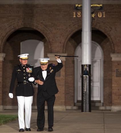 The guest of honor and hosting official are introduced to the attendees during the Staff Noncommissioned Officer Evening Parade at Marine Barracks Washington D.C., Aug. 4, 2017. The guest of honor for the parade was retired Marine Corps Col. Archie Simpson, Guadalcanal veteran, and the hosting official was Lt. Gen. James B. Laster, director, Marine Corps Staff. (Official Marine Corps photo by Cpl. Robert Knapp/Released)