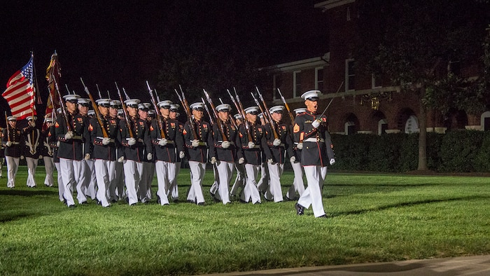 "Staff Sgt. Said Lemarhi, platoon sergeant, U.S. Marine Corps Silent Drill Platoon, marches his platoon across the parade deck as a part of ""pass and review"" during the Staff Noncommissioned Officer Evening Parade at the Barracks, Aug. 4, 2017. The guest of honor for the parade was retired Marine Corps Col. Archie Simpson, Guadalcanal veteran, and the hosting official was Lt. Gen. James B. Laster, director, Marine Corps Staff. (Official Marine Corps photo by Cpl. Robert Knapp/Released)"
