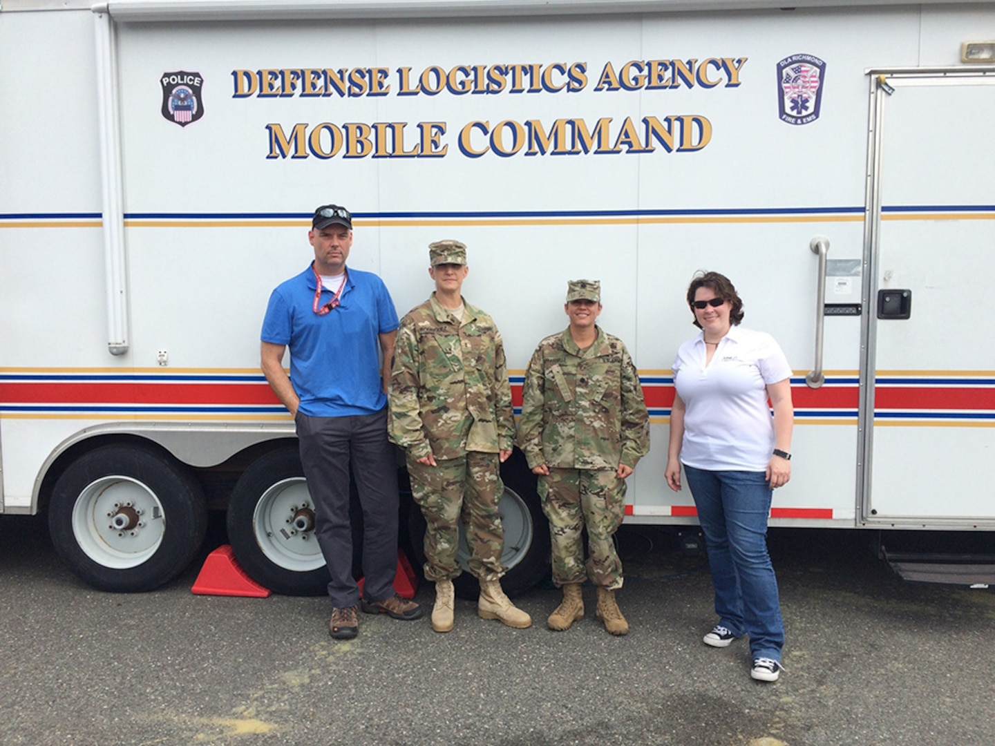 DLA Energy Americas East at Houston team pose for a photo by the DLA Mobile Command Vehicle