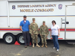 DLA Energy Americas East at Houston Commander Army Lt. Col. Josiel Carrasquillo-Morales (second right) and poses in front of DLA Mobile Command Vehicle with Task Force Americas team during Quartermaster Liquid Logistics Exercise at Joint Base Mcguire-Dix-Lakehurst, New Jersery. Also in photo (left to right): Ben Beadles, Chief Warrant 2 Rodriguez and Katherine Meadows