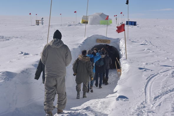 Journalists get a look inside of the East GRIP underground station July 29, 2017. Here, scientists drill through the Northeast Greenland Ice Stream to receive ice core samples to study. Journalists had a chance to visit during a mission the wing was conducting to provide cargo to the camp. (U.S. Air National Guard photo by Senior Master Sgt. William Gizara/Released)