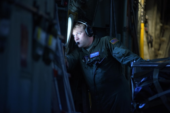 OVER GREENLAND - Airman 1st Class Ryan Rhoades, a student loadmaster with the 139th Airlift Squadron, on a flight to East GRIP (East Greenland Ice-core Project) from Kangerlussuaq, Greenland, on July 29, 2017. That was the 13th mission the 109th Airlift Wing made to East GRIP this season to transport cargo and scientists.  (U.S. Air National Guard photo by Senior Airman Jamie Spaulding/Released)