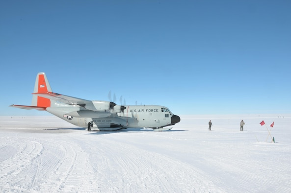 An LC-130 Skibird sits on the skiway at Summit Camp, Greenland, on July 30, 2017, during a mission from Kangerlussuaq, Greenland, to supply the camp here with cargo and fuel. That was the 24th mission the 109th Airlift Wing made here season. (U.S. Air National Guard photo by Master Sgt. Catharine Schmidt/Released)