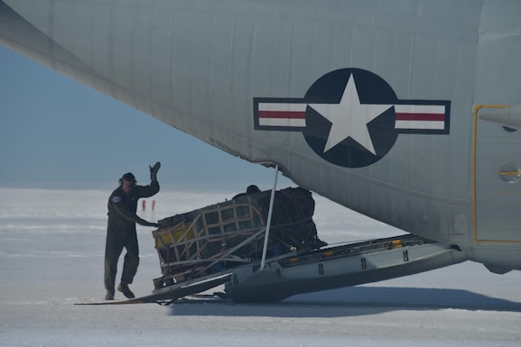 Master Sgt. Randy Powell loads a training pallet onto an LC-130 aircraft here July 28, 2017. Powell is an instructor loadmaster with the 139th Airlift Squadron based out of Stratton Air National Guard Base, Scotia, New York. Raven Camp is used to train aircrews on LC-130 operations on skiways. (U.S. Air National Guard photo by Senior Master Sgt. Willie Gizara/Released)