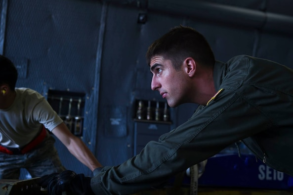 Senior Airman Ryan MacAdam, 9th Airlift Squadron loadmaster, pushes a cargo pallet inside a C-5M Super Galaxy during Mobility Guardian, Air Mobility Command's premier exercise, July 30, 2017, at Little Rock Air Force Base, Ark. Essential training was accomplished on various levels by the pilots, loadmasters and flight engineers who participated. (Courtesy photo)