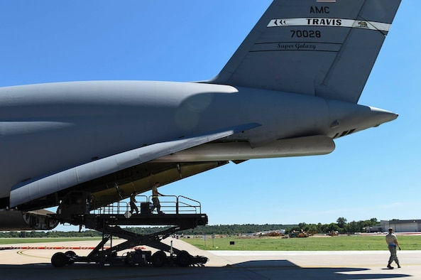 A C-5M Super Galaxy operated by the 9th Airlift Squadron takes part in Mobility Guardian, Air Mobility Command's premier exercise, July 30, 2017, at Little Rock Air Force Base, Ark. The 9th AS, based out of Dover AFB, Del., borrowed this Travis AFB C-5M through the duration of the exercise. (Courtesy photo)