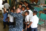 Navy Chaplain (Lt. Cmdr.) Clifford Rutledge takes a selfie with students at República de Colombia Elementary School in Silin, Honduras, Aug. 1, 2017. Sailors participated in a community relations project as part of Southern Partnership Station 2017, a U.S. Navy deployment focused on subject-matter-expert exchanges with partner-nation militaries and security forces in Central and South America. Navy photo by Petty Officer 1st Class Jeremy Starr