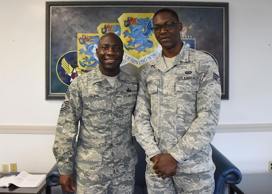 Chief Master Sgt. Vegas Clark, 81st Training Wing command chief, and Senior Airman Kadeem Daniel, 81st Contracting Squadron contract specialist, pose for a photo at the 81st TRW headquarters building Aug. 8, 2017, on Keesler Air Force Base, Miss. Daniel participated in the Command Chief for a Day program which highlights outstanding enlisted performers from around the wing. Each Airman selected for the program spends the day shadowing Clark to learn what it takes to be a command chief. (U.S. Air Force photo by Kemberly Groue)