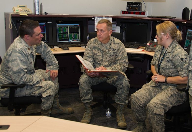 Lt. Gen. David J. Buck, Commander, 14th Air Force (Air Forces Strategic), Air Force Space Command; and Commander, Joint Functional Component Command for Space, U.S. Strategic Command, sits down with Maj. Christopher Bert and Senior Airman Samantha Krivanek, 6th Space Operations Squadron