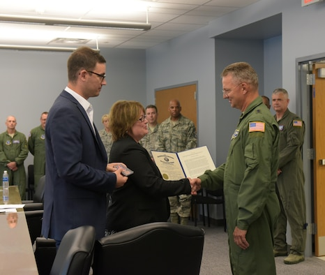 Maj. Gen. Anthony German (right), New York Adjutant General, presents Marcy and Matt Steiner with the New York State Conspicuous Service Medal awarded to the late Chuck Steiner during a dedication ceremony at Stratton Air National Guard Base, Scotia, New York, on Aug. 4, 2017. The 109th Airlift Wing's new wing conference room was dedicated to Chuck Steiner, president of the Capital Region Chamber, who passed away in April. (U.S. Air National Guard photo by Senior Master Sgt. William Gizara/Released)