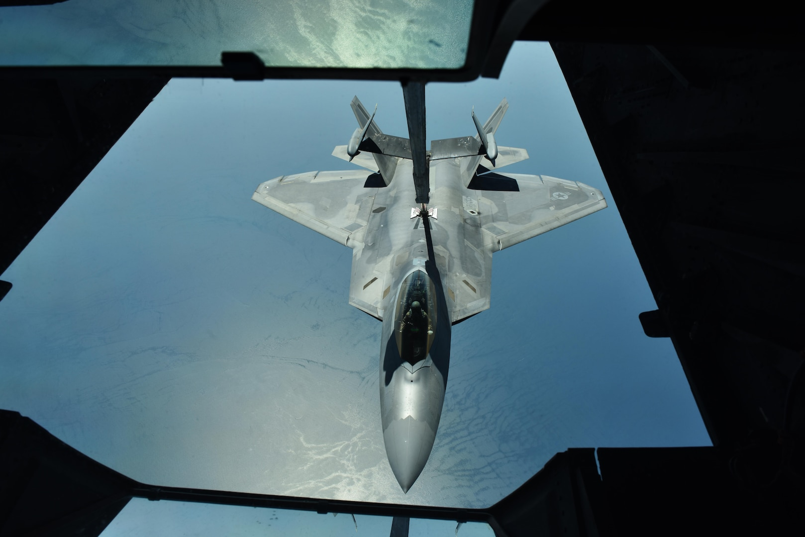 Lt. Gen. Jeffrey L. Harrigian, commander of U.S. Air Forces Central Command, refuels his F-22A Raptor from a KC-10 Extender over the Persian Gulf, June 30, 2017. Harrigian served as the wingman of outgoing 380th Air Expeditionary Wing Commander Brig. Gen. Charles S. Corcoran during his fini-flight. The two generals flew in support of Combined Joint Task Force-Operation Inherent Resolve and the fight against ISIS. (U.S. Air Force photo by Staff Sgt. Marjorie A. Bowlden)