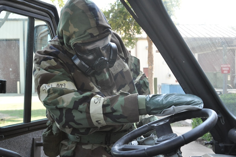 An Airman from the 301st Mission Support Group also learns how to decontaminate a vehicle after a simulated chemical attack scenario during Ability to Survive and Operate (ATSO) training Saturday, Aug. 5, 2017 at Naval Air Station Fort Worth Joint Reserve Base, Texas. Airmen also familiarized themselves with wearing Mission Oriented Protective Posture (MOPP) gear. (U.S. Air Force photo/ Tech. Sgt. Charles Taylor)
